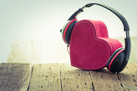 Headphones with red  heart. love music. vintage retro Stock Photo