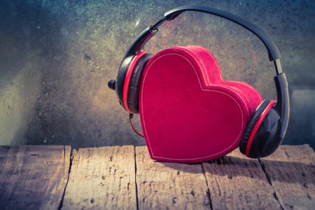Headphones with red  heart. love music. vintage retro Stock fotó