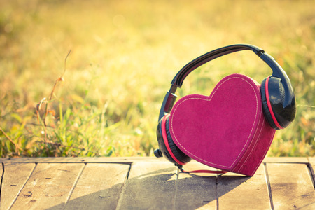 Headphones with red heart. love music. vintage retro