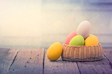 eggs: Easter eggs in the nest on rustic wooden background