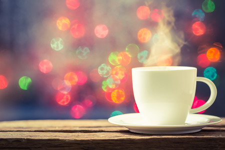 vapour: Steaming cup of coffee over bokeh background Stock Photo