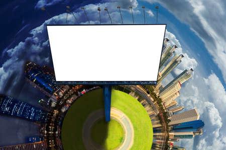 Big white blank billboard in modern city over blue sky background.