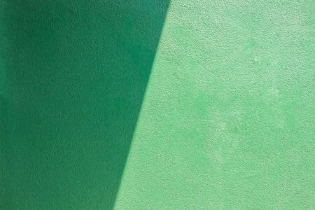 two and a half: Green wall of cement.light and shadow Stock Photo
