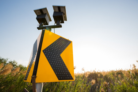 Road sign solar cell , beware Stock Photo