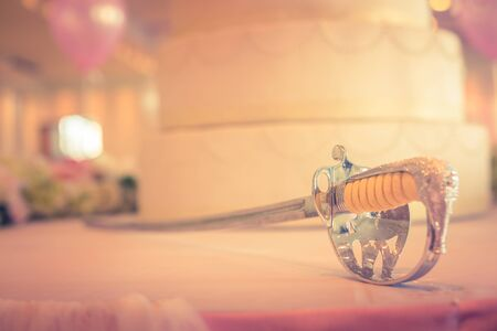 luxuries: Saber with cake for wedding Stock Photo
