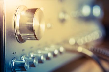 electronic music: volume control knob of vintage hi-fi amplifier