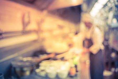 hat top hat: blur chef of a restaurant kitchen