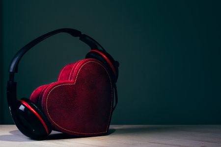 love music: Headphones with red heart. love music. vintage retro
