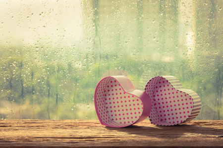 love box: Couple love box in front glass window with rainy