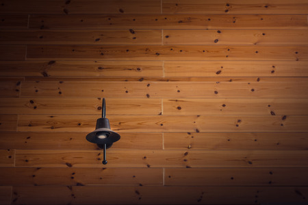 interior spaces: Black lamp on wood wall