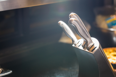 Low light set of knives for kitchen Stock Photo