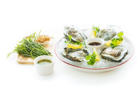 Fresh Oyster Surat Thani(Thailand) with  Cherry Balsamic and Lemon,isolated on white Stock Photo