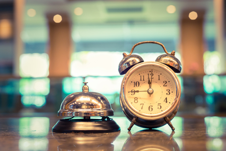 Restaurant bell vintage with old alarm clock Standard-Bild
