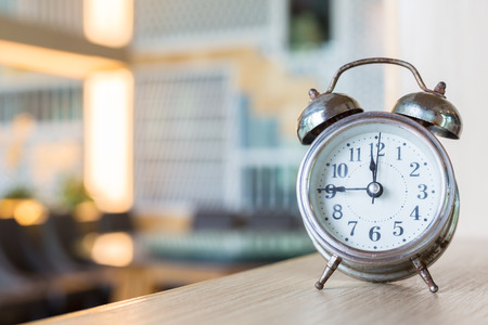 desaturated: Blurred background with retro alarm clock on table