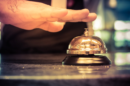 Hand of a man using a hotel bell,vintage