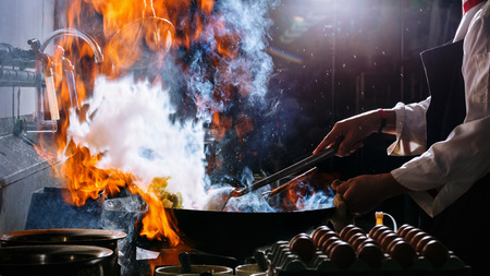 Fire burn is cooking on iron pan,stir fire very hot