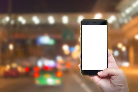 emergency braking: Mobile smart phone behind a blur of traffic. Stock Photo