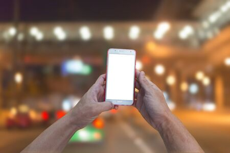 Mobile smart phone behind a blur of traffic. Stock Photo