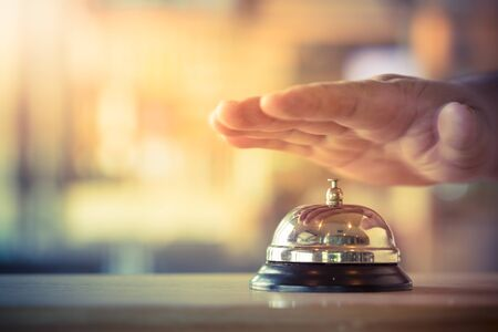 Restaurant bell vintage with hand Editorial