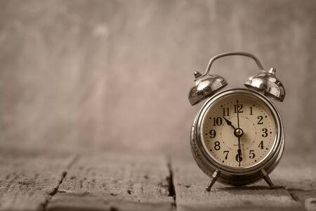 alarmclock: Vintage background with retro alarm clock on table