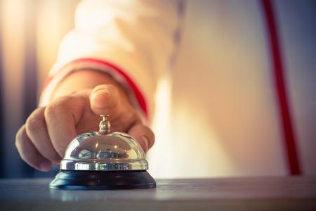 Restaurant bell vintage with hand Foto de archivo