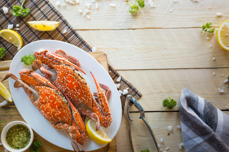 Top view,Steamed Blue swimming crab on  wooden table background.