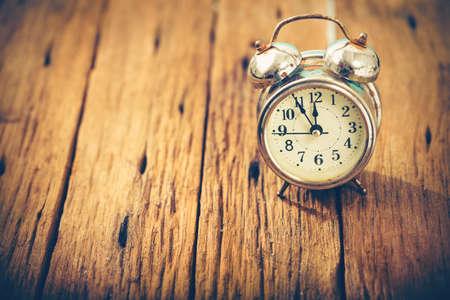 Alarm clock vintage on wood