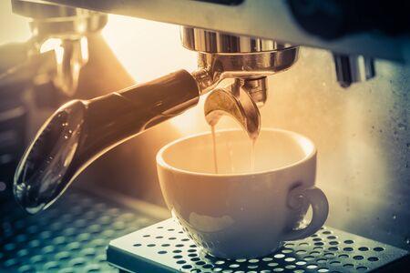 steel. milk: Professional coffee machine making espresso in a cafe