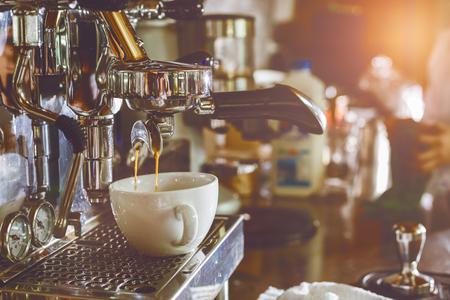 Professional coffee machine making espresso in a cafe