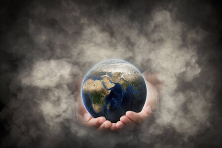 Hands that protect earth and the environment from pollution is concept, Safe world concept