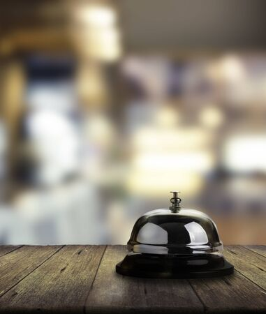Call bell for service on wooden. Bokeh background