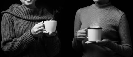 Women join of coffee drink, Black and white photo filter Stock fotó