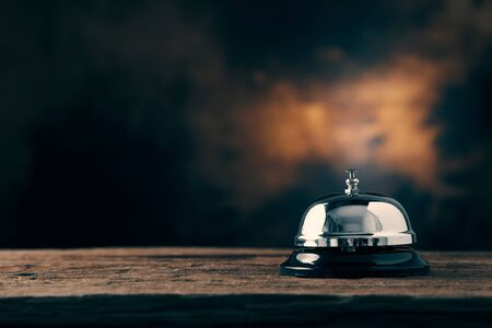 Bell of service on wood table with dark background Stock fotó