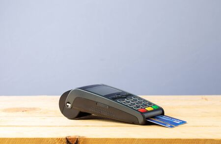 Credit card machine on wood Stock Photo