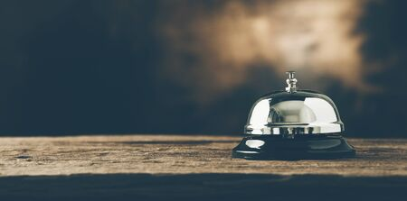 Bell of service on wood. dark filter. panoramic photo