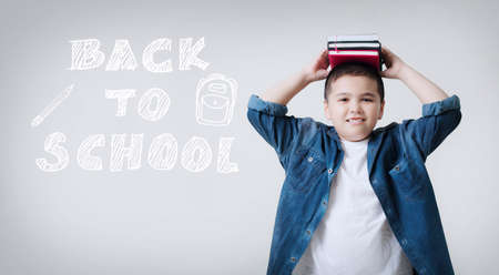 Happy smiling boy  with concept back to school,