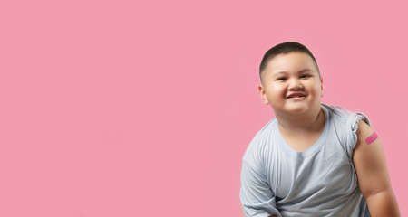 Vaccinated boy Showing Arm After   Vaccine Injection, Copy space background