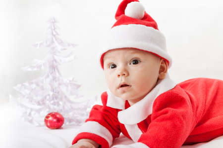 klaus: baby Santa Claus with a Christmas tree and toys