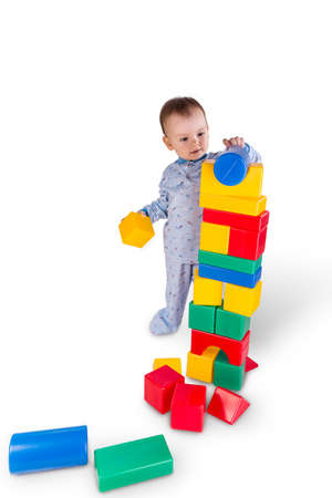 plastic bricks: child playing with colored plastic bricks  and cubes Stock Photo