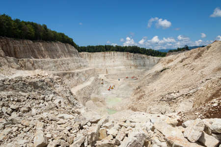 Stone quarry with excavate photo