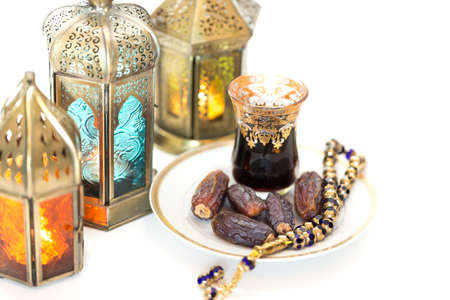 Decoration for the holi month of Ramadan with lamps, tasbih, dates and kawa - a traditional Arabic tea