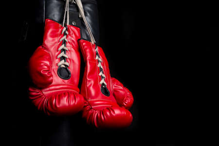 padding: Red boxing gloves with low key lighting Stock Photo