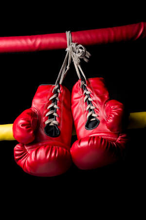 low key lighting: Pair of red boxing gloves with low key lighting Stock Photo