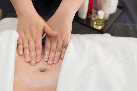 relax massage: Massage series : Therapist massaging client stomach