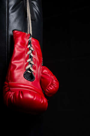 low key lighting: Red boxing gloves with low key lighting Stock Photo