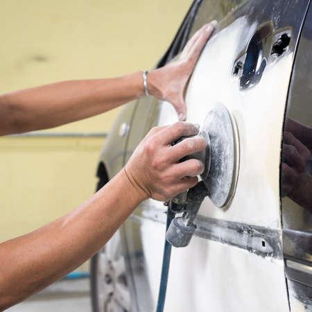 auto repair: Auto body repair series: Sanding paint Stock Photo