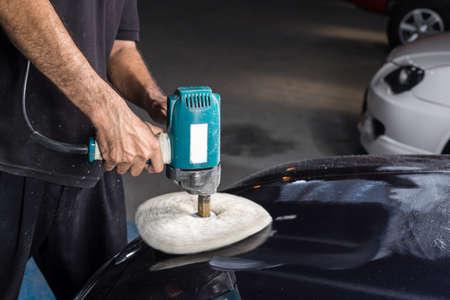 buffing: Car polishing series : Polishing blue car Stock Photo