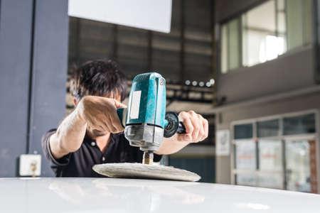Car polishing series : Worker waxing white car Stock fotó