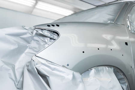 repaint: Auto body repair series : Masked silver car before repaint