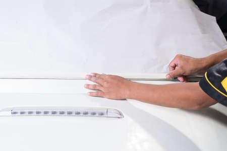 repaint: Auto body repair series : Masked white car before repaint Stock Photo